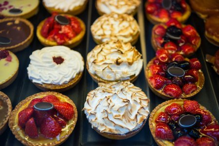 Photo for Close up view of different tarts placed in rows - Royalty Free Image