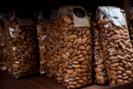 close up view of almonds in plastic packaging