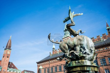 COPENHAGEN, DENMARK - MAY 6, 2018: Dragon Fountain at city hall square during daytime