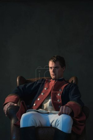 Photo for Man in empire style sitting in chair. - Royalty Free Image