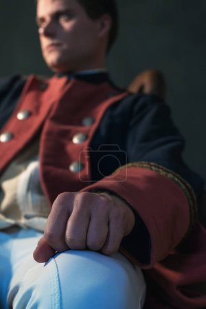 Photo for Hand of historical regency man sitting in chair. - Royalty Free Image