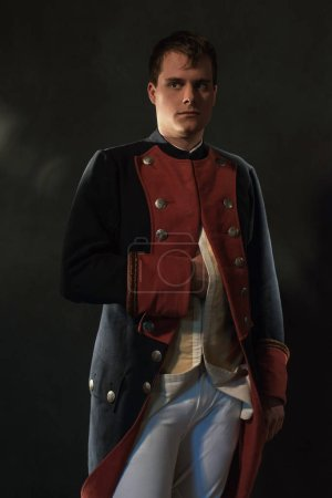 Photo for Serious historical regency man holds hand in jacket. - Royalty Free Image