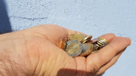 hand holdins coins money isolated for background
