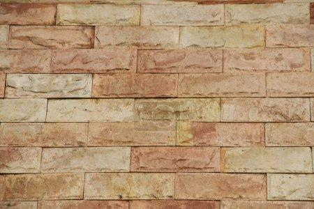 Foto de Sand stone brick wall texture background - Imagen libre de derechos