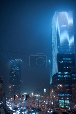 Photo for Night lights of modern city, skyscrapers buildings - Royalty Free Image
