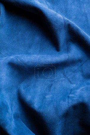Photo pour Plis sur fond de tissu bleu - image libre de droit