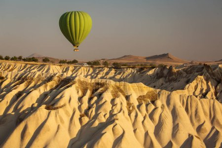 Photo for Beautiful landscape of Cappadocia valley with hot air balloons in background at sunrise - Royalty Free Image