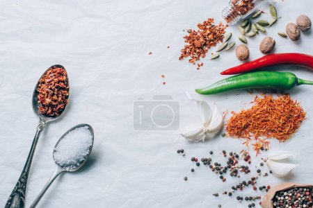 top view of spices and vegetables on white table