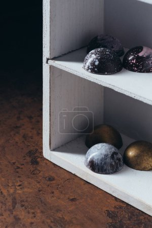 closeup image of different chocolate candies on shelves
