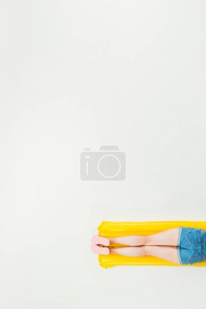 cropped shot of woman lying on inflatable mattress isolated on white