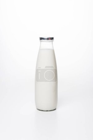 close-up shot of fresh milk in bottle on white surface