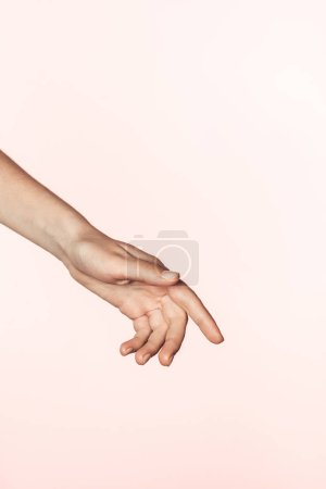 cropped image of woman gesturing by hand isolated on pink background