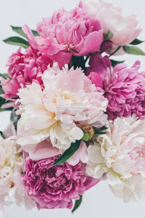 top view of beautiful pink peony bouquet on white