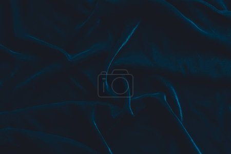 Luxurious dark blue velvet fabric background