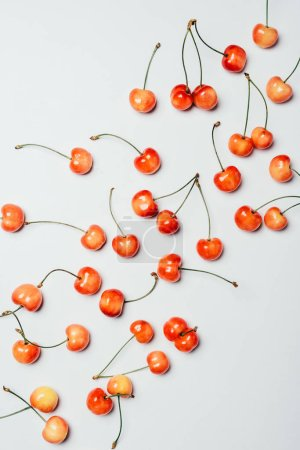 top view of fresh ripe sweet cherries on white background