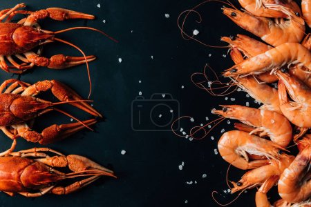 Photo for Top view of crayfishes and shrimps placed in rows on table with salt - Royalty Free Image