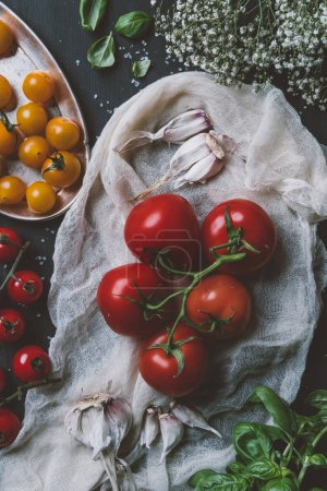 Photo for Top view of organic red tomatoes and yellow cherry tomatoes on gauze - Royalty Free Image