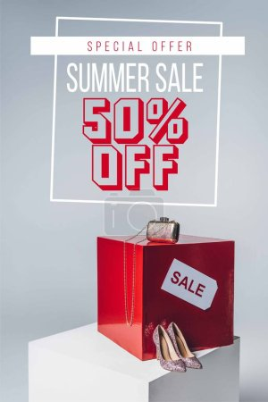 handbag, high heels and sale sign, summer sale concept with fifty off