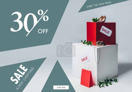 twigs with green leaves, high heels and sale signs, summer sale concept