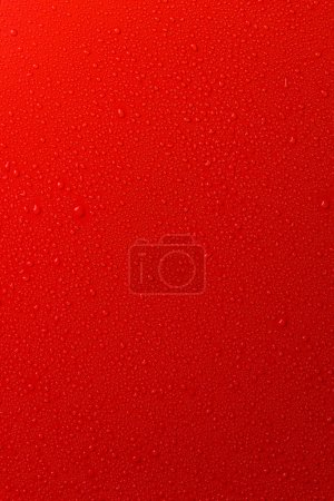 red empty surface with water drops