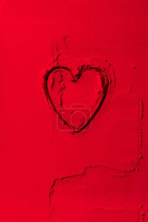 Photo for Elevated view of shape of cookie cutter in shape of heart on red powder - Royalty Free Image