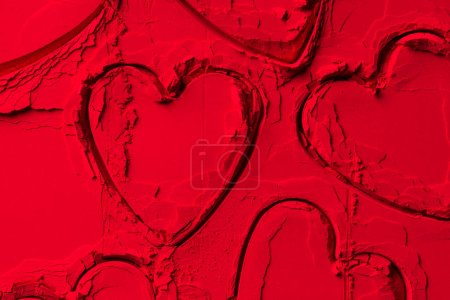 Photo for Elevated view of shapes of cookie cutters in shape of hearts on red powder - Royalty Free Image