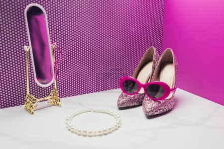 real size vintage stylish sunglasses with shoes and pearl necklace in miniature room with toy mirror