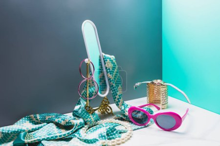 toy mirror with silk scarf and accessories in miniature blue room
