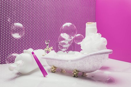toy bath with real size personal hygiene supplies and soap bubbles in miniature room