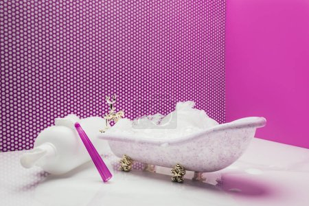 toy bath with real size shampoo and shaver in miniature room