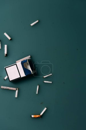 top view of cigarettes and package flowing in water, ecology protection concept