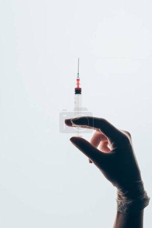 cropped shot of doctor holding syringe isolated on white