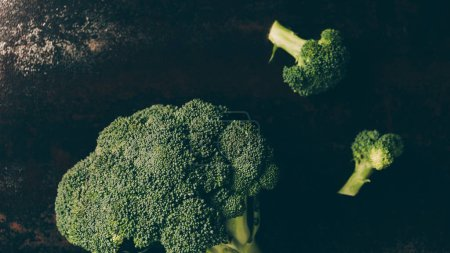 top view of green broccoli on grey dark table