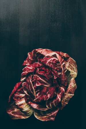 Photo for Top view of red salad on grey dark table - Royalty Free Image
