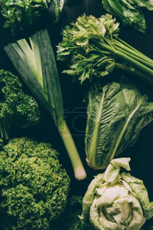 Photo for Top view of leek, green salad and parsley on table - Royalty Free Image