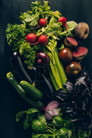 Photo for Top view of radishes, eggplants and beetroots on grey dark table - Royalty Free Image