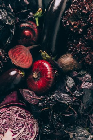 top view of red cabbage, aubergines and beetroots on table