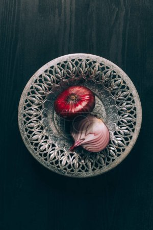 Photo for Top view of red onions on grey plate - Royalty Free Image