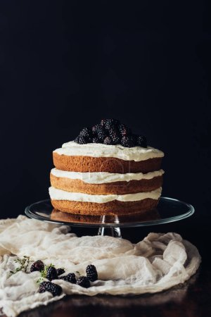 Photo for Delicious blackberry cake on glass stand and on cheesecloth - Royalty Free Image