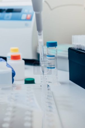 selective focus of pipette in modern biotechnology laboratory