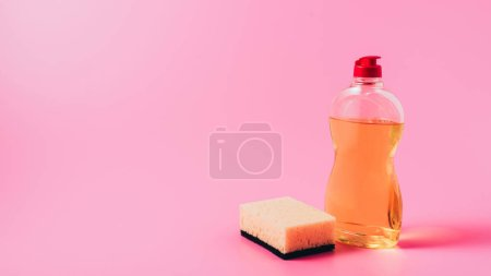 Close up view of dishwashing liquid and washing sp...
