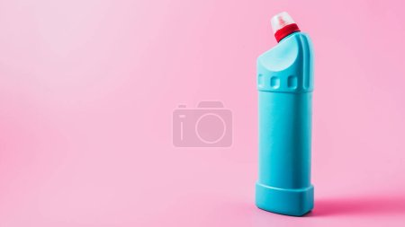 close up view of cleaning fluid, pink background