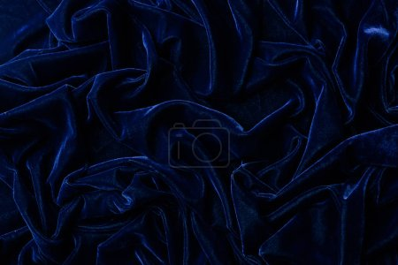 top view of dark blue velvet textile as background