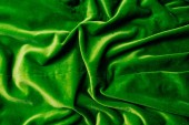 top view of green shiny velvet textile as background