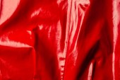 top view of red leather shiny textile as background