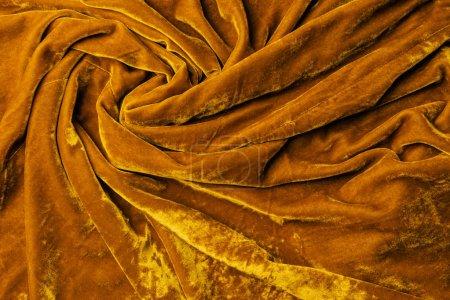 top view of dark orange velvet textile as background