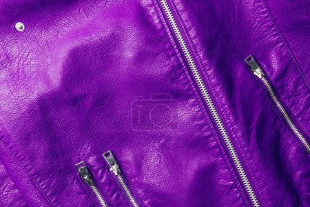 Photo for Top view of violet leather shiny textile with zippers as background - Royalty Free Image
