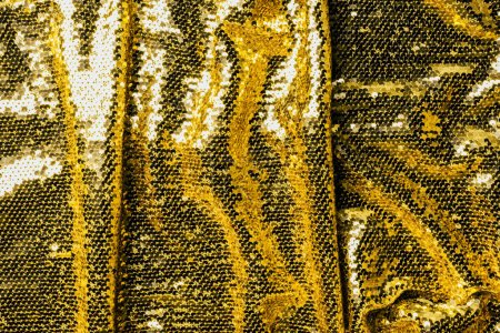 Photo for Top view of golden textile with shiny sequins as background - Royalty Free Image
