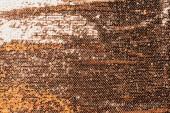 vue du textile doré avec des paillettes brillantes comme toile de fond
