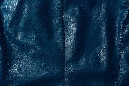 Photo pour Vue du textile brillant en cuir bleu foncé comme toile de fond - image libre de droit